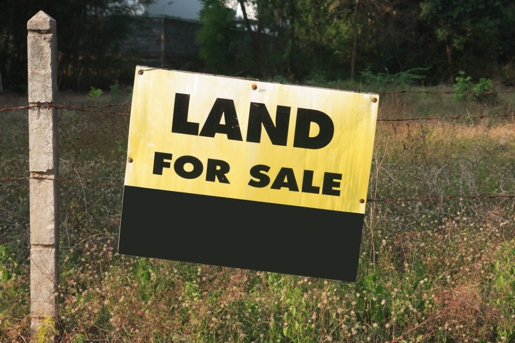 Signboard showing a message of land for sale